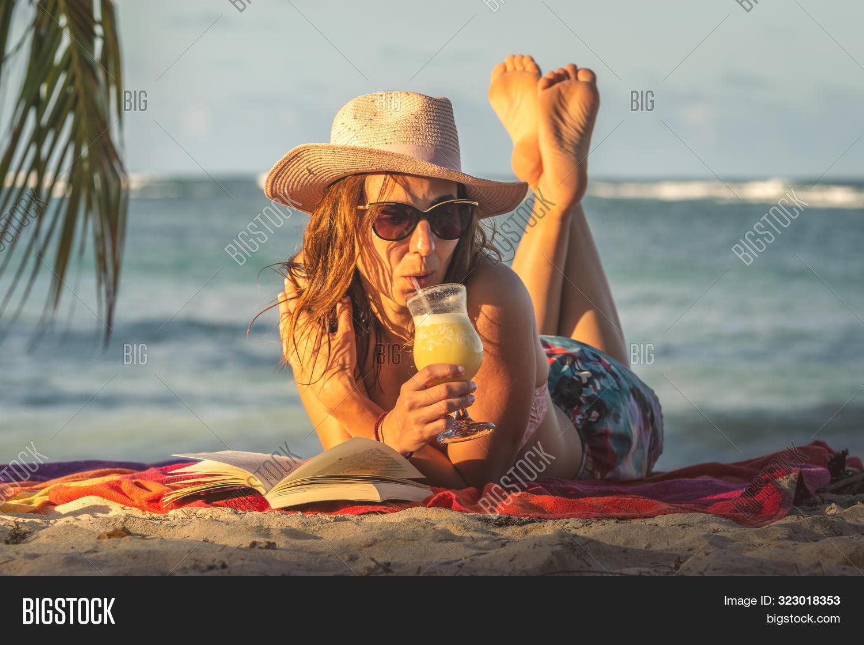 Traveler Girl Relaxing On Tropical Beach. Young Girl Traveler Relaxing In Vacation. Traveler Relaxin