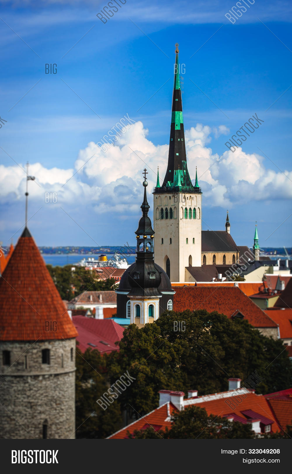 Scenic summer aerial panorama of the Old Town architecture in Tallinn, Estonia, Cloudy blue sky