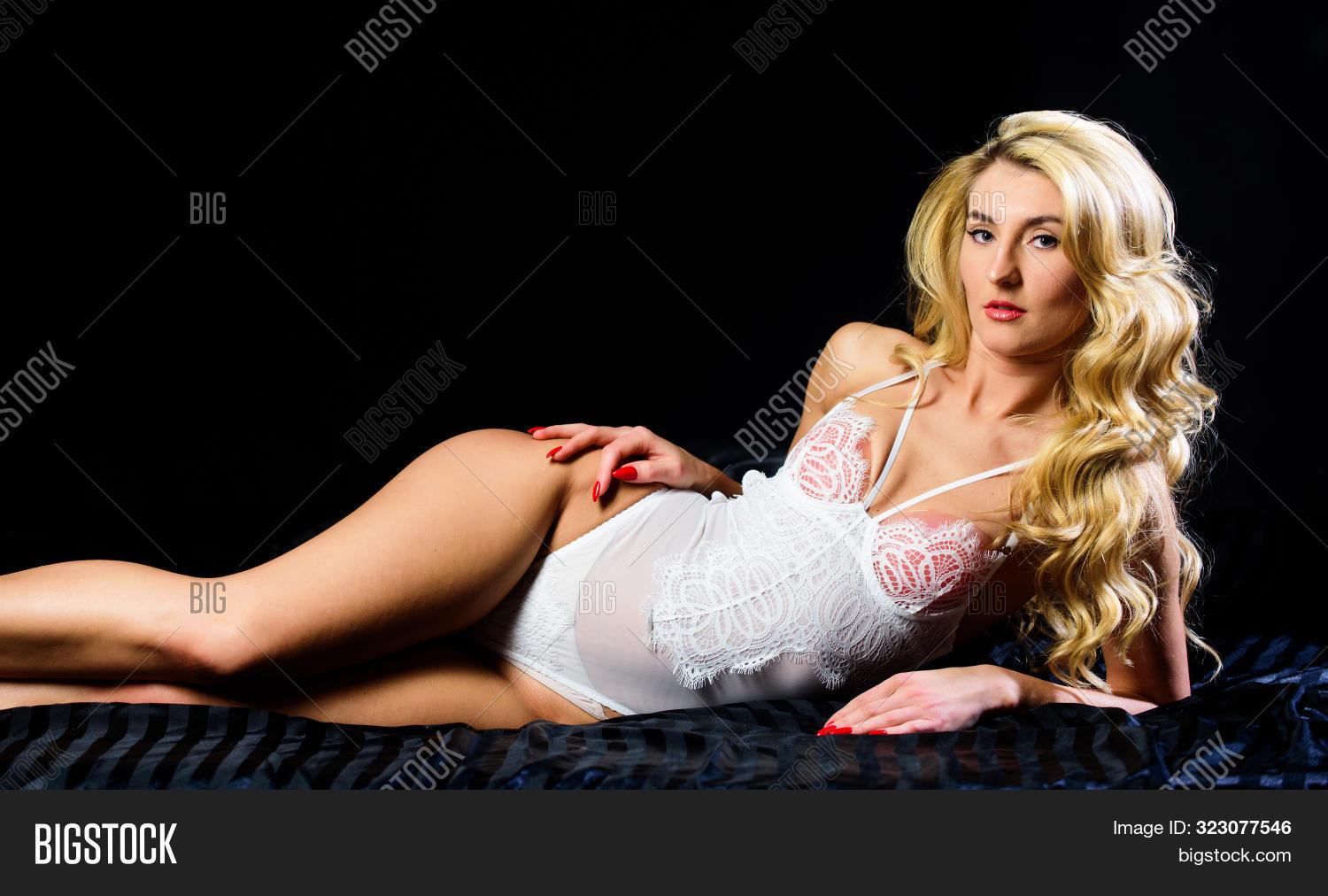 Beautiful Seductress. Seductive Sexy Young Woman In Lingerie. Girl Sexy Fashion Model Long Curly Hai