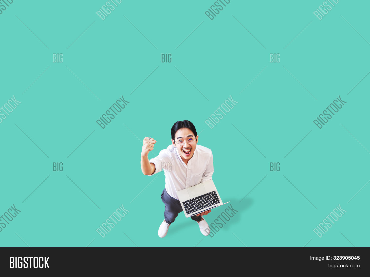 Top View Of Cheerful Asian Man Holding Computer Laptop On Isolated Background Feeling Win ,celebrati