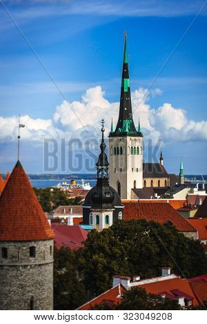 Scenic summer aerial panorama of the Old Town architecture in Tallinn, Estonia, Cloudy blue sky stock photo