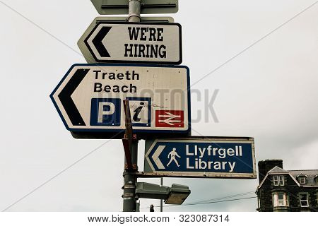 Conceptual hand writing showing We Re Hiring. Business photo text Advertising Employment Workforce Placement New Job Advertisement concept with empty copy space on the road sign. stock photo