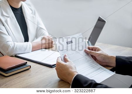Employer arriving for a job interview, businessman listen to candidate answers explaining about his profile and colloquy dream job, manager sitting in job Interview talking in office. stock photo
