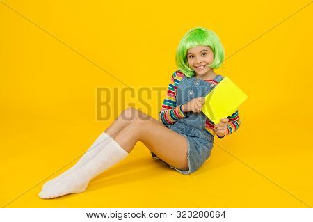 Anime Comics. Comics Store. Anime Fan. Cheerful Kid In Bright Colorful Wig. Cosplay Party Concept. H
