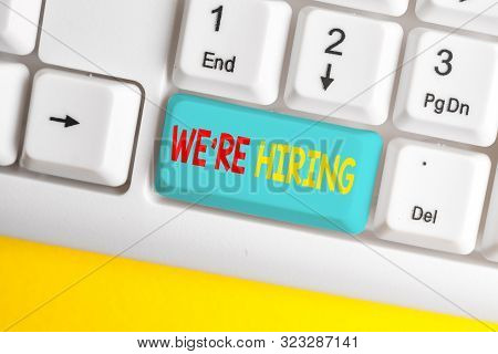 Word writing text We Re Hiring. Business concept for Advertising Employment Workforce Placement New Job White pc keyboard with empty note paper above white background key copy space. stock photo