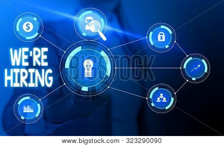 Text sign showing We Re Hiring. Conceptual photo Advertising Employment Workforce Placement New Job Woman wear formal work suit presenting presentation using smart device. stock photo