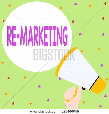 Handwriting text writing Re Marketing. Concept meaning Strategy to reach potential customers in your website Hand Holding Loudhailer Empty Round Speech Text Balloon Announcement New. stock photo