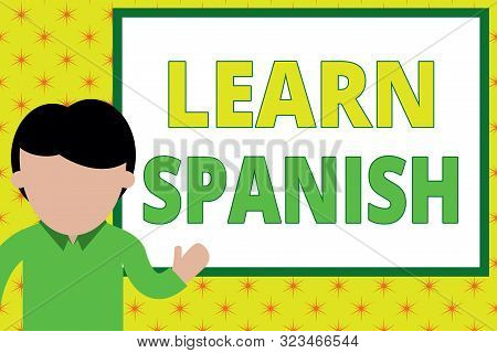 Handwriting text writing Learn Spanish. Concept meaning Translation Language in Spain Vocabulary Dialect Speech Young man standing in front whiteboard pointing to project. photo Art. stock photo