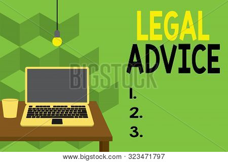 Text sign showing Legal Advice. Conceptual photo Lawyer opinion about law procedure in a particular situation Front view open laptop lying on wooden desktop light bulb falling glass. stock photo