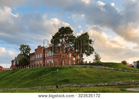 Secondary school buiding built in 19th century during sunset. UNESCO island town of Sviyazhsk, Republic of Tatarstan, Russia. stock photo