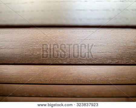 Polished wooden roman blinds with wood grain stock photo
