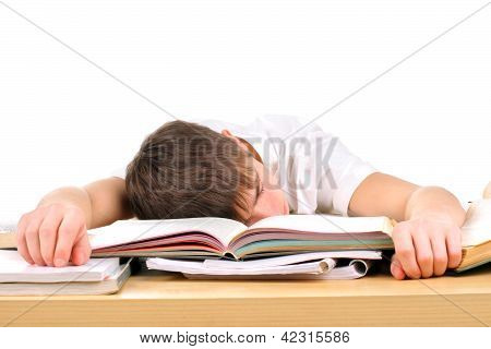 tired teenager lying and sleeping on the books stock photo