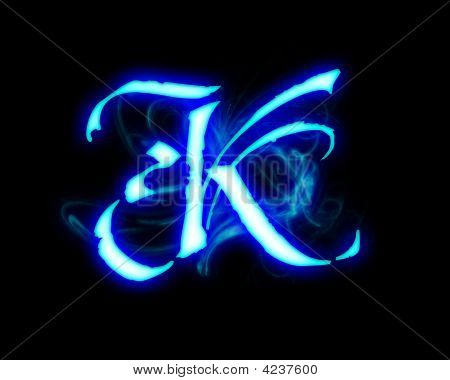 stock photo of blue flame magic font over black background. letter