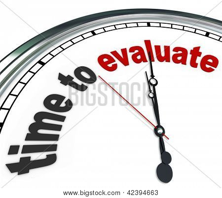 The words Time to Evaluate on an ornate white clock, counting down to the moment a manager will perform an evaluation, review, assessment or reevaluation of a worker, property or process stock photo