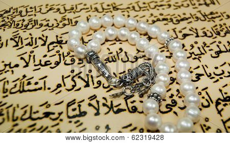 islamic rosary beads over quran writings paternoster stock photo