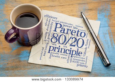 Pareto principle or eighty-twenty rule - word cloud on a napkin with a cup of coffee stock photo
