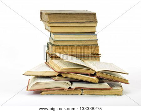 Old books pile vertical isolated on a white background stock photo