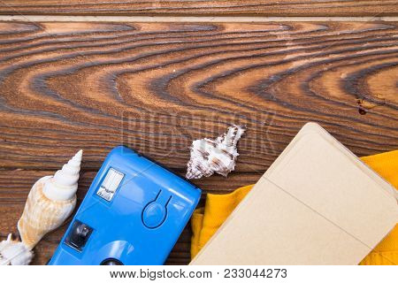 Preparing For Vacation, Travel Or Journey. Travel Planning. Booking Hotel. Dark Wooden Background Wi