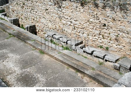 These are the public toilets at the ruins from Ancient Philippi. These toilets date to the 3rd century AD. Philippi was the home of Lydia the merchant who befriended the Apostle Paul in Acts 16 of the Bible. stock photo