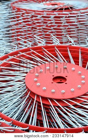 New red tedder for trailer in agricultural machinery for gathering hay. Close up stock photo