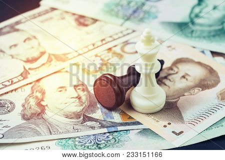 US and China finance tariff trade war concept, black loser and white winner chess king on US dollar and china yuan banknotes, world major market countries, import and export barrier. stock photo