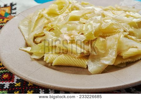 Haluski Pan-Fried Cabbage And Noodles,  soft noodles or dumplings cooked in the Central and Eastern European cuisines. stock photo