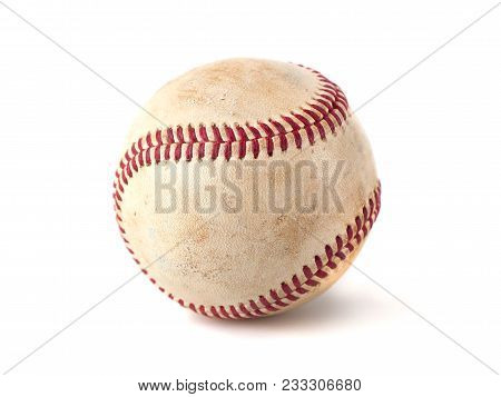 Close up macro view of red stitched seams of an worn baseball. stock photo