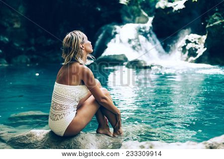 Young woman enjoying natural bathing by the Kawasan waterfall in Philippines stock photo
