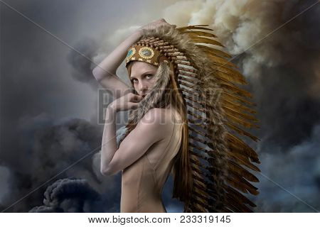 American Indian with plume of feathers on storm background with gray clouds, concept of peace and balance with nature, environment and care of planet earth stock photo