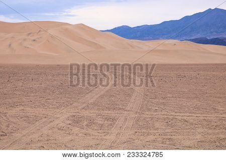 Dune Buggie tracks leading up to sand dunes taken at the Dumont Sand Dunes in the Mojave Desert, CA stock photo