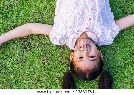Eco Friendly Environment Concept With Happy Healthy Asian Kid Having Fun Relaxing Outdoor On Natural