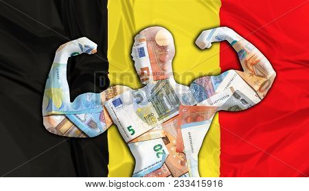 Abstract business background. Concept of powerful European EURO. Flag of Belgium and bodybuilder shaped EUR currency. Financial concept about exchange rate of Belgian Euro currency. stock photo