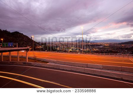 Freeway and panoramic view of western side of the city, Vitacura, Santiago, Chile stock photo