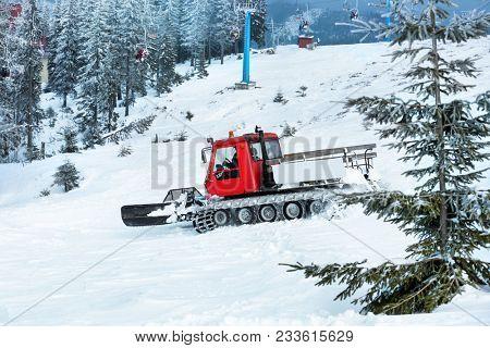 Snowplow machine at snowy ski resort stock photo