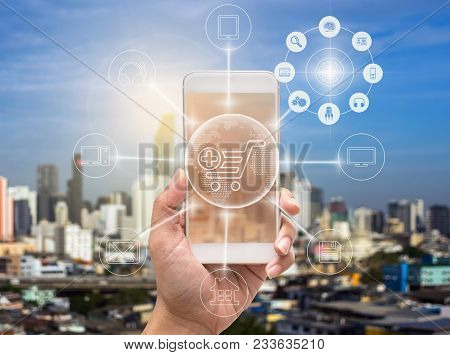 holding smart phone showing the mobile payments and online shopping with moni channel over the cityscape background,business omni channel or multi Channel concept, 3D illustration stock photo