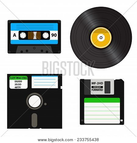 Set of media of different generations - vinyl record, cassette tape, a 3.5-inch floppy disk on a 5.25-inch diskette. Isolated on white background. stock photo