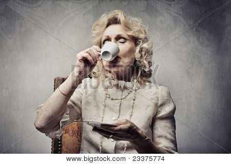 Senior woman drinking a cup of coffee stock photo