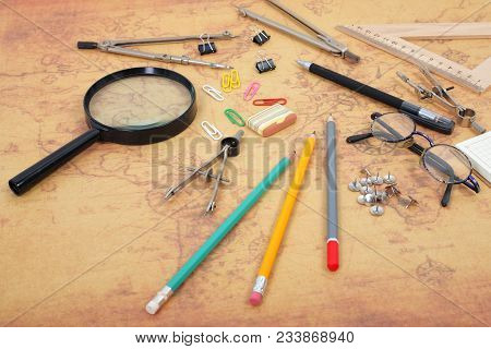 Science and education - Desktop of the scientist objects map background stock photo
