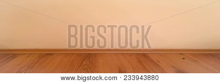 Room wood floor perspective, grunge pastel painted concrete wall and wooden laminate planks grou. Old room background. Washed oak parquet pattern stock photo