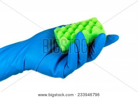 A hand in the rubber blue glove holding a cleaning sponge, ready for household cleaning tasks. stock photo