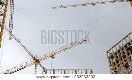 Tower crane against the blue sky, large plan, details stock photo