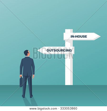 Outsource or inhouse - signpost. Businessman in front of a road sign. The choice of man. Banner outsourcing concept. Vector illustration flat design. Isolated on background. stock photo
