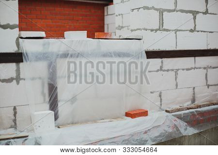 construction of a private cottage house: white gas blocks, aerated concrete, bricks stock photo