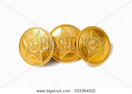 Buttons with the symbols of the USSR. Yellow buttons of a military clothes of the USSR period with a star, a sickle and a hammer stock photo