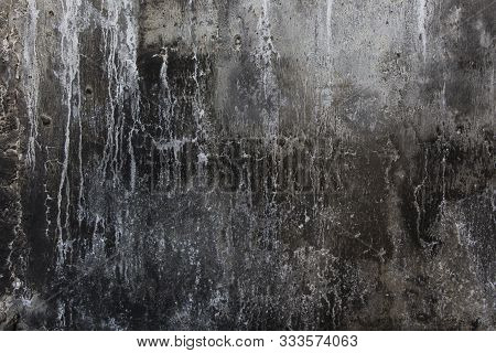 burned wall texture background,  grunge wall, black and white grunge background, rough black burned concrete wall background with whitewash scratche stock photo