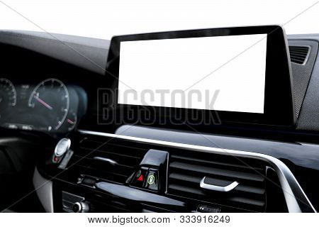 Monitor in car with isolated blank screen use for navigation maps and GPS. Isolated on white with clipping path. Car detailing. Car display with blank screen. Modern car interior details. Mock up stock photo