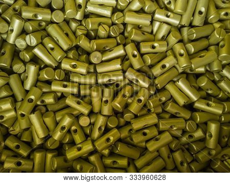 A batch of small sulfur oxidated anodized aluminium parts stock photo