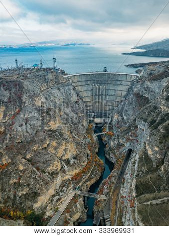 Dam of Chirkey hydroelectric power plant in Dagestan, Russia, aerial view stock photo