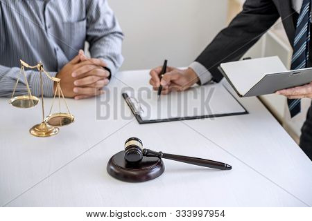 Consultation and conference of Male lawyers and professional businessman working and discussion having at law firm in office. Concepts of law, Judge gavel with scales of justice.. stock photo