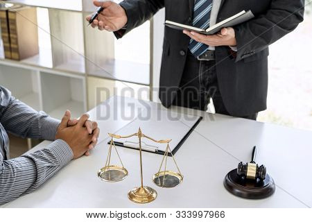 Male lawyer or Counselor working in courtroom have meeting with client are consultation with contract papers of real estate, Law and Legal services concept. stock photo